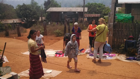 Once one lady saw us and set down her scarves for display, the entire village came out to sell their wares.