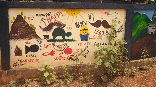 A wall painted by the students of the village school.